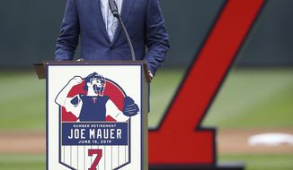 Former Minnesota Twins player Joe Mauer speaks to the crowd after his No. 7 was retired prior to a baseball game against the Kansas City Royals, Saturday, June 15, 2019, in Minneapolis. (AP Photo/Stacy Bengs)