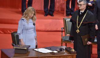 New Slovak President Zuzana Caputova takes her presidential oath during a parliamentary session in Bratislava, Slovakia, Saturday, June 15, 2019. (Vaclav Salek/CTK via AP)