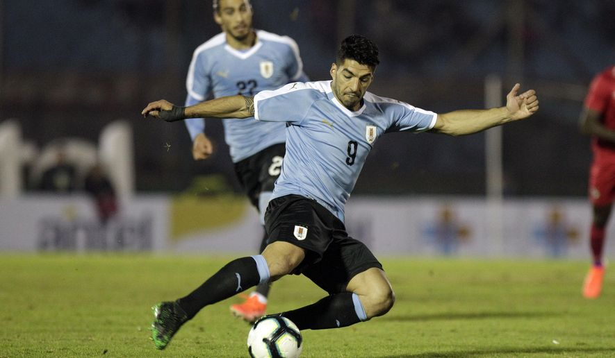 Luis Suarez of Uruguay strikes the ball during a pre-Copa America friendly soccer match against Panama, in Montevideo, Uruguay, Friday, June 7, 2019. Brazil will host the Copa America tournament, which runs from June 14 through July 7. (AP Photo/Matilde Campodonico)