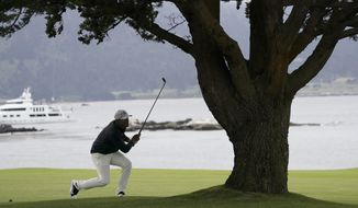 Brooks Koepka watches his shot from 18th fairway during the third round of the U.S. Open golf tournament Saturday, June 15, 2019, in Pebble Beach, Calif. (AP Photo/Carolyn Kaster)
