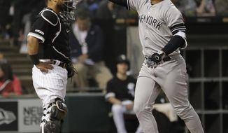 New York Yankees' Gleyber Torres, right, celebrates after hitting a two-run home run as Chicago White Sox Welington Castillo looks to the field during the fourth inning of a baseball game in Chicago, Saturday, June 15, 2019. (AP Photo/Nam Y. Huh)