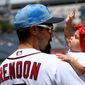 The Nationals' Anthony Rendon holds his 10-month-old daughter Emma on the field before Sunday's game. (Associated Press)