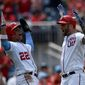 The Washington Nationals' Matt Adams (right) celebrates his three-run home run with Juan Soto in the third inning of a 15-5 win over the Arizona Diamondbacks on Sunday. Adams had a career-high seven RBI after he added a grand slam in the eighth inning. (ASSOCIATED PRESS)