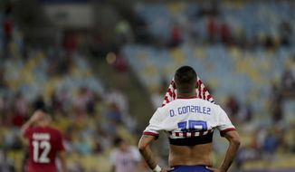 Paraguay's Derlis Gonzalez covers his face after his side's 2-2 draw with Qatar in a Copa America Group B soccer match at the Maracana stadium in Rio de Janeiro, Brazil, Sunday, June 16, 2019. (AP Photo/Silvia Izquierdo)