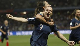 France's Eugenie Le Sommer, celebrates with France's Amel Majri after scoring her side's second goal on a penalty kick during the Women's World Cup Group A soccer match between France and Norway in Nice, France, Wednesday, June 12, 2019. (AP Photo/Claude Paris)