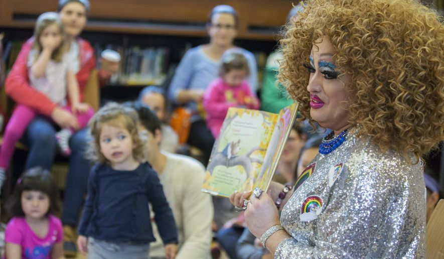 A drag queen reads to children during the Feminist Press' presentation of Drag Queen Story Hour at the Park Slope Branch of the Brooklyn Public Library, in New York, May 13, 2017. (AP Photo/Mary Altaffer) ** FILE **