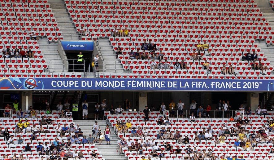 Spectators follow the Women's World Cup Group F soccer match between Sweden and Thailand at the Stade de Nice in Nice, France, Sunday, June 16, 2019. (AP Photo/Claude Paris)
