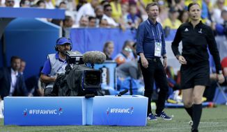 A cameraman films the Women's World Cup Group F soccer match between Sweden and Thailand at the Stade de Nice in Nice, France, Sunday, June 16, 2019. FIFA has demanded Saudi-backed satellite broadcaster Arabsat stop transmitting pirated feeds of Women's World Cup games from a Qatari network in an ongoing sports television rights dispute linked to the Gulf diplomatic crisis. (AP Photo/Claude Paris)