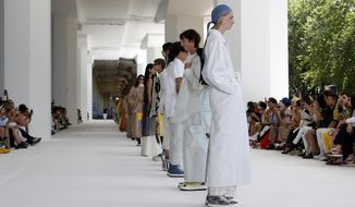Models wear creations as part of the Sunnei men's Spring-Summer 2020 collection, unveiled during the fashion week in Milan, Italy, Sunday, June 16, 2019. (AP Photo/Antonio Calanni)