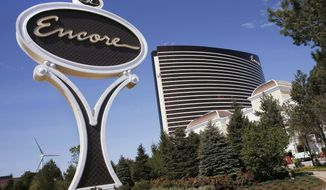 FILE - This May 22, 2019 file photo shows Encore Boston Harbor in Everett, Mass. The $2.6 billion Wynn resort casino is scheduled to open June 23 transforming a contaminated property into what is billed as a waterfront oasis. (AP Photo/Michael Dwyer, File)