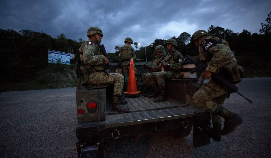 Soldiers wearing the armbands of Mexico's National Guard board a truck to patrol back roads that migrants use to avoid a migration checkpoint, north of Comitan, Chiapas State, Mexico, Saturday, June 15, 2019. Under pressure from the U.S. to slow the flow of migrants north, Mexico plans to deploy thousands of National Guard troops by Tuesday to its southern border region.(AP Photo/Rebecca Blackwell)