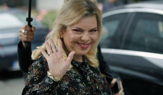 FILE - In this June 6, 2018 file photo, Sara Netanyahu, the wife of Israel's Prime Minister Benjamin Netanyahu, arrives for the meeting with French Finance Minister Bruno Le Maire at Bercy Economy Ministry, in Paris, France. A Jerusalem magistrate court on Sunday, June 16, 2019, sentenced Netanyahu, to pay a fine of more than $15,000 for misusing state funds. The sentencing comes after she agreed to a plea bargain that ended the years-long saga of just one of the high-profile corruption cases involving the prime minister's family. (AP Photo/Francois Mori, File)