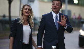 Istanbul's mayoral candidate Ekrem Imamoglu, candidate of the secular opposition Republican People's Party, or CHP, accompanied by his wife, name not given, arrives for a televised debate with Binali Yildirim, of Turkey's ruling Justice and Development Party, or AKP, ahead of the June 23 re-run of Istanbul elections, Sunday, June 16, 2019. Televised election debates are uncommon in Turkey. The last one, between AKP leader Recep Tayyip Erdogan and the then-leader of the CHP, took place before a 2002. The AKP has been in power since. (AP Photo/Emrah Gurel)