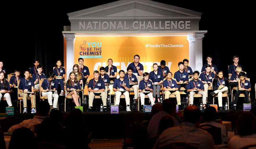 The 42 competitors in the You Be the Chemist National Challenge answer questions about chemistry displayed on a screen Monday, at the Omni Shoreham Hotel in Northwest. (Emily Ketterer/ The Washington Times)