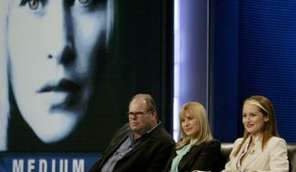"""wNBC's """"Medium"""" Executive producer, Glen Gordon Caron, left, actress Patricia Arquette, center and Allison Dubois speak to the media Friday Jan. 21, 2005 at the Television Critics Association winter meeting in Los Angeles. It's been a tough year for NBC, which is in third place behind CBS and resurgent ABC among viewers aged 18 to 49. """"Medium"""" is one of the network shows that have shown signs of modest success. (AP Photo/Nick Ut) **FILE**"""