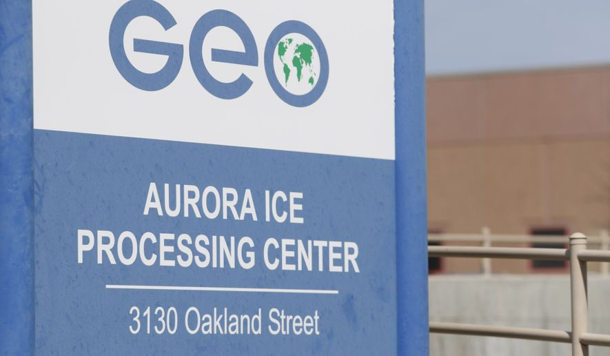 This Saturday, April 15, 2017, photograph shows the entrance to the GEO Group's immigrant detention facility in Aurora, Colo. People once held in a privately run Colorado immigration detention center are challenging the system used to keep it clean and maintained, arguing it borders on slavery. They have won the right to sue GEO Group on behalf of an estimated 60,000 people held at its detention center near Denver over a decade. (AP Photo/David Zalubowski)