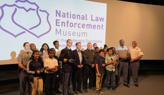 The National Law Enforcement Museum Fund awards the Prince George's County Police Department its Hero Award for community involvement for the department's Police Athletic League program for county youth on Monday, June 17, 2019. (Ximena Bustillo /The Washington Times)