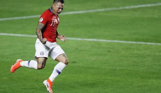 Chile's Eduardo Vargas celebrates scoring his side's 4th goal during a Copa America Group C soccer match against Japan at the Morumbi stadium in Sao Paulo, Brazil, Monday, June 17, 2019. (AP Photo/Nelson Antoine)