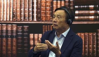 Huawei founder Ren Zhengfei speaks at a roundtable at the telecom giant's headquarters in Shenzhen in southern China on Monday, June 17, 2019. Huawei's founder has likened his company to a badly damaged plane and says revenues will be $30 billion less than forecast over the next two years. (AP Photo/Dake Kang)