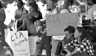 University of New Mexico students in Albuquerque, N.M. forced the CIA to cancel a recruitment event at the Student Union Building in Sept. 1988. An active-duty CIA intelligence officer will be embedded on the University of New Mexico's campus and will carry a teaching or research load comparable to faculty colleagues, according to a new agreement. (Jeff Alexander/The Albuquerque Journal via AP)