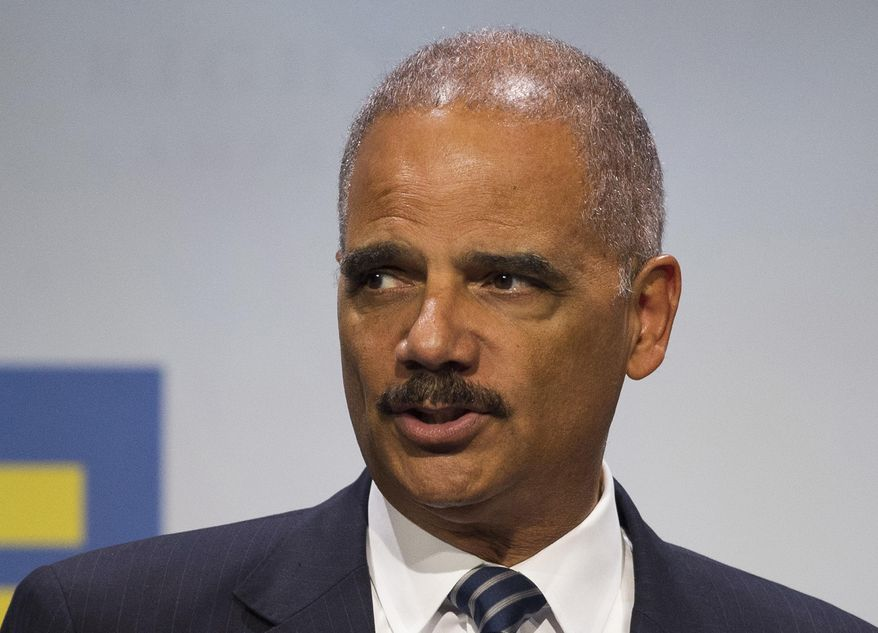 In this Sept. 15, 2018 file photo, former Attorney General Eric Holder addresses the Human Rights Campaign National Dinner in Washington, D.C. (AP Photo/Cliff Owen, File)
