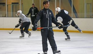 FILE - In this Oct. 8, 2015, file photo, San Diego Gulls coach Dallas Eakins watches during hockey practice in San Diego. Dallas Eakins is the Anaheim Ducks' new coach. The Ducks announced the move Monday, June 17, 2019, filling the NHL's last head coaching vacancy with the veteran coach of their AHL affiliate in San Diego. (AP Photo/Lenny Ignelzi, File)