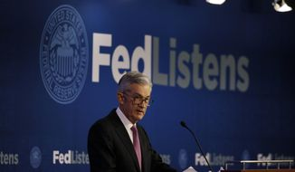 In this June 4, 2019, file photo Federal Reserve Chairman Jerome Powell speaks at a conference involving its review of its interest-rate policy strategy and communications in Chicago. On Wednesday, June 19, the Federal Reserve releases its latest monetary policy statement and updated economic projections. (AP Photo/Kiichiro Sato, File)