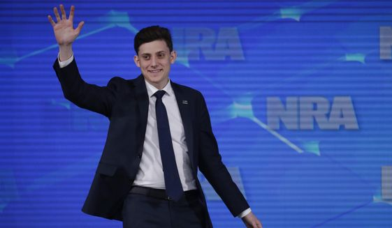 FILE - In this April 26, 2019 file photo, Kyle Kashuv, a survivor of the Marjory Stoneman Douglas High School shooting in Parkland, Fla., speaks at the National Rifle Association Institute for Legislative Action Leadership Forum in Indianapolis. On Monday, June 17, 2019, Kashuv said that Harvard University revoked his acceptance over racist comments he made online and in text messages about two years ago. (AP Photo/Michael Conroy, File)