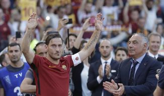 """FILE - In this Sunday, May 28, 2017 file photo, Roma President James Pallotta, right, applauds as Francesco Totti waves to his fans after an Italian Serie A soccer match between Roma and Genoa at the Olympic stadium in Rome. Former Roma captain Francesco Totti has announced, Monday, June 17, 2019, that he is leaving his position within Roma's management because his views were not taken into consideration. Totti says that he """"never had the chance to express myself"""" in decisions over the hiring and firing of coaches and moves in the player transfer market. Speaking at an extraordinary news conference at the Italian Olympic Committee, Totti says """"it's a day that I hoped never would have come."""" (AP Photo/Alessandra Tarantino, File)"""
