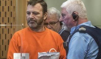 Philip Neville Arps, left, appears for sentencing in the Christchurch District Court, in Christchurch, New Zealand, Tuesday, June 18, 2019.  The Christchurch businessman who shared a video of worshippers being slaughtered at a New Zealand mosque has been sentenced to 21 months in prison. (John Kirk-Anderson/Pool via AP)
