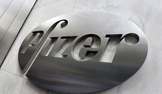 This Dec. 4, 2017, file photo shows the Pfizer company logo at the company's headquarters in New York. Pfizer is buying the cancer treatment company Array BioPharma in a deal worth $11.4 billion. Array has a combination therapy for BRAF-mutant metastatic melanoma, along with a pipeline of targeted cancer medicines in development and a portfolio of other medicines that are expected to generate significant royalties over time. (AP Photo/Richard Drewm Fuke, File)