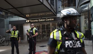 Toronto Police secure the scene where shots were fired during the Toronto Raptors NBA basketball championship parade in Toronto, Monday, June 17, 2019. (Andrew Lahodynskyj/The Canadian Press via AP) **FILE**