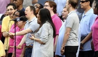 Members of Daniel's Music Foundation sing the national anthem prior to a baseball game between the New York Yankees and the Tampa Bay Rays, Monday, June 17, 2019, in New York. (AP Photo/Sarah Stier)