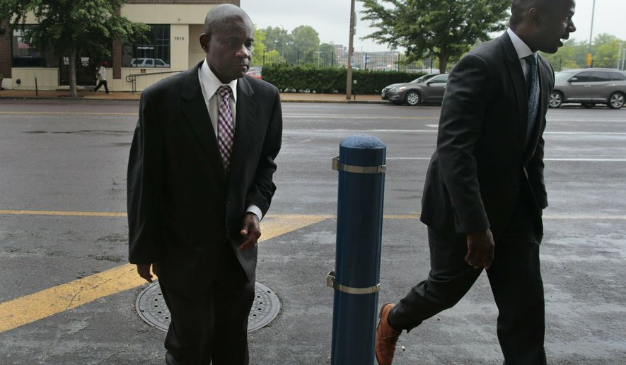 Former FBI agent William Don Tisaby, left, is accompanied by attorney Jermaine Wooten as he turns himself in at St. Louis Police headquarters on Monday, June 17, 2019, in St Louis. Tisaby has been charged in a perjury investigation related to the prosecution of former Missouri Gov. Eric Greitens. (Robert Cohen/St. Louis Post-Dispatch via AP)