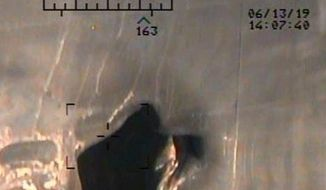 This image released by the U.S. Department of Defense on Monday, June 17, 2019, and taken from a U.S. Navy helicopter, shows what the Navy says is blast damage to the motor vessel M/T Kokuka Courageous, consistent with a limpet mine attack.  (U.S. Department of Defense via AP)