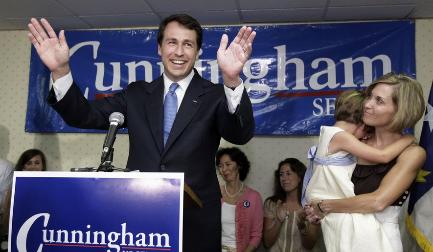 In this June 22, 2010, file photo, Democratic U.S. Senate candidate Cal Cunningham, left, acknowledges supporters as his wife Elizabeth, right, with their daughter, Caroline, looks on at his campaign rally headquarters in Lexington, N.C., after losing in a runoff election to Elaine Marshall. Cunningham, a former North Carolina state legislator, on Monday, June 17, 2019, entered the Democratic race to challenge Republican incumbent U.S. Sen. Thom Tillis, whose seat would be considered a major pickup for Democrats trying to win back the Senate majority next year. (AP Photo/Chuck Burton, File)