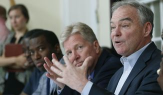 U.S. Sen. Tim Kaine, D-Va., right, gestures during a gun violence prevention roundtable discussion along with Richmond Mayor Levar Stoney, left, and Virginia Secretary of Public Safety, Brian Moran, center, in Richmond, Va., Monday, June 17, 2019. (AP Photo/Steve Helber) **FILE**