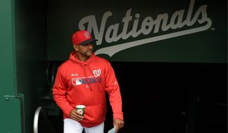 Washington Nationals manager Dave Martinez walks in the dugout before a baseball game against the New York Mets, Sunday, March 31, 2019, in Washington. The Nationals won 6-5.(AP Photo/Nick Wass) **FILE**