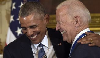 President Barack Obama laughs with Vice President Joe Biden during a ceremony in the State Dining Room of the White House in Washington, Thursday, Jan. 12, 2017. Obama presented Biden with the Presidential Medal of Freedom. (AP Photo/Susan Walsh) ** FILE **