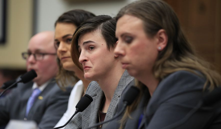 From left, transgender military members Navy Lt. Cmdr. Blake Dremann, Army Capt. Alivia Stehlik, Army Capt. Jennifer Peace and Army Staff Sgt. Patricia King, listen to an emotional committee member Rep. Debra Haaland, D-N.M. relate to the witnesses about her daughter who is gay during a House Armed Services Subcommittee on Military Personnel hearing on Capitol Hill in Washington, Wednesday, Feb. 27, 2019. This is the first ever hearing that transgender military members openly testified in Congress. (AP Photo/Manuel Balce Ceneta)