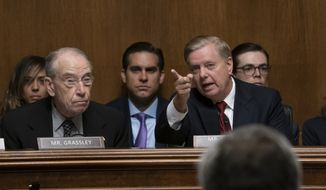 Senate Judiciary Committee Chairman Sen. Lindsey Graham, R-S.C., joined at left by Sen. Chuck Grassley, R-Iowa, left, gives an opening statement before swearing-in Attorney General William Barr to testify, on Capitol Hill in Washington, Wednesday, May 1, 2019. (AP Photo/J. Scott Applewhite) ** FILE **