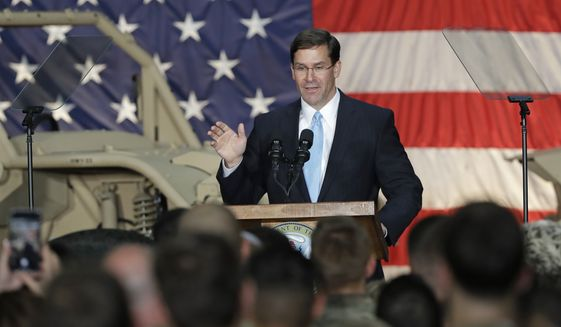 Secretary of the Army Mark Esper speaks to soldiers and family members in Ft. Bragg, N.C., Monday, April 15, 2019. (AP Photo/Chuck Burton) ** FILE **