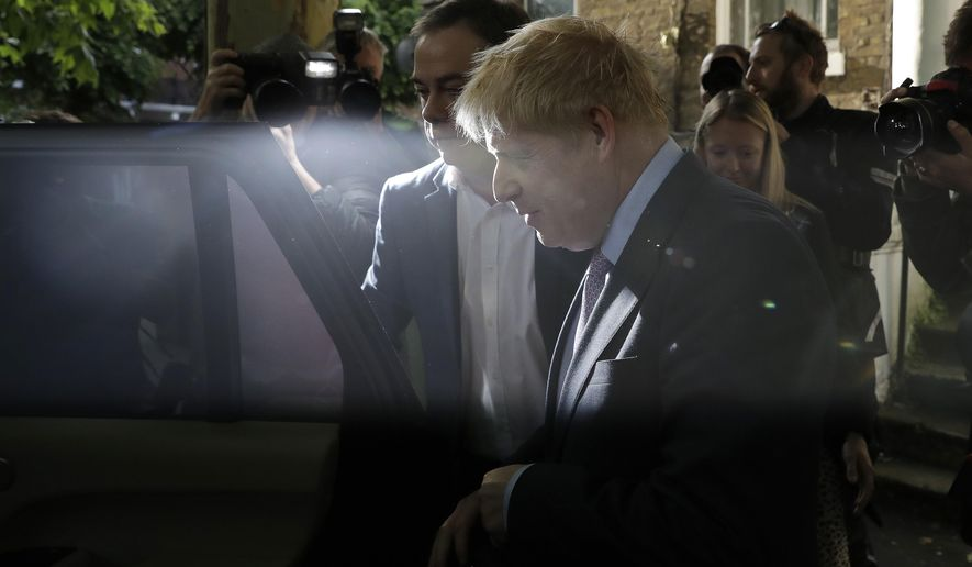 British Conservative party leadership contender Boris Johnson gets in a car as he leaves home in south London, Tuesday, June 18, 2019. Contenders for leadership in Britain's ruling Conservative Party to become the next Prime Minister, jostled for attention Monday as the race narrowed into a contest to seize the mantle of challenger to front-runner Boris Johnson. (AP Photo/Matt Dunham)