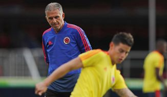 Colombia's coach Carlos Queiroz, left, looks as James Rodriguez trains during a practice session of the national soccer team in Sao Paulo, Brazil, Tuesday, June 18, 2019. Colombia will face Qatar on Wednesday in a Group B match of the Copa America soccer tournament. (AP Photo/Nelson Antoine)
