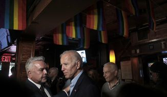 Henry Munoz, left, former Democratic National Committee finance chairman, meets with former Vice President and 2020 Presidential Candidate Joe Biden, center, during his visit to the Stonewall Inn, site of a series of violent confrontations between the gay community and police in 1969, Tuesday June 18, 2019, in New York. Biden has paid a visit to the Stonewall Inn ahead of the 50th anniversary of an uprising that helped spark the gay rights movement. (AP Photo/Bebeto Matthews)