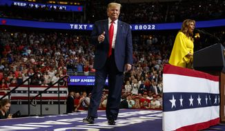 President Donald Trump arrives to speak at his re-election kickoff rally at the Amway Center, Tuesday, June 18, 2019, in Orlando, Fla., as first lady Melania Trump speaks. (AP Photo/Evan Vucci)