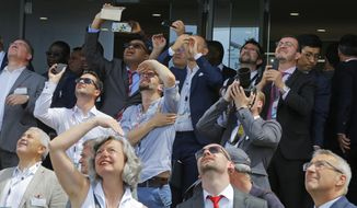 Visitors watch a demonstration flight at Paris Air Show, in Le Bourget, east of Paris, France, Tuesday, June 18, 2019. The world's aviation elite are gathering at the Paris Air Show with safety concerns on many minds after two crashes of the popular Boeing 737 Max. (AP Photo/Michel Euler)
