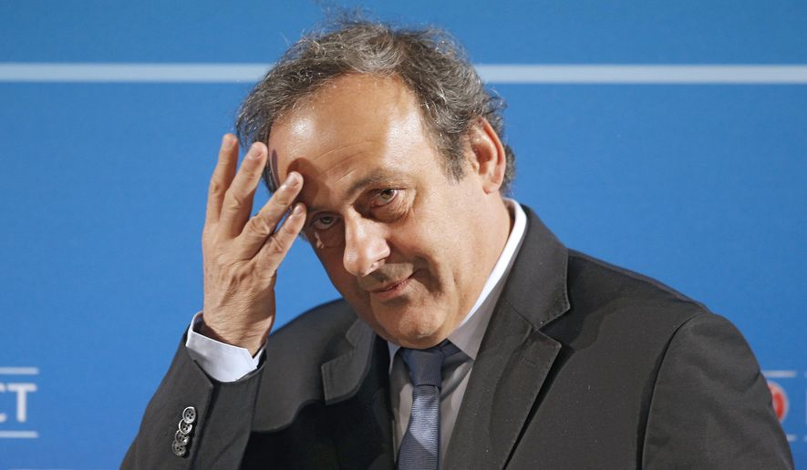 In this Feb.22, 2014 file photo, UEFA President Michel Platini arrives at a press conference, one day prior to the UEFA EURO 2016 qualifying draw in Nice, southeastern France. Former UEFA president Michel Platini has been arrested Tuesday June 18, 2019 over the awarding of the 2022 World Cup. (AP Photo/Lionel Cironneau, File) **FILE**