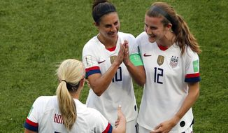 United States' Carli Lloyd, center, celebrates with Lindsey Horan and Tierna Davidson, right, after scoring the opening goal during the Women's World Cup Group F soccer match between the United States and Chile at the Parc des Princes in Paris, Sunday, June 16, 2019. (AP Photo/Thibault Camus)