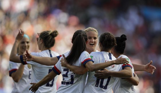 US players celebrate after teammate Carli Lloyd scored their side's third goal during the Women's World Cup Group F soccer match between United States and Chile at Parc des Princes in Paris, France, Sunday, June 16, 2019. (AP Photo/Alessandra Tarantino) **FILE**